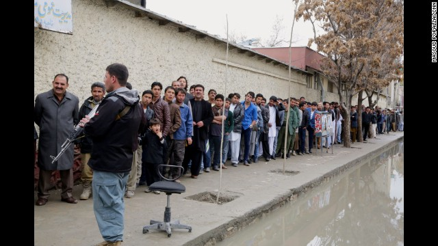 Men line up to vote outside a polling station in Kabul on April 5, 2014.