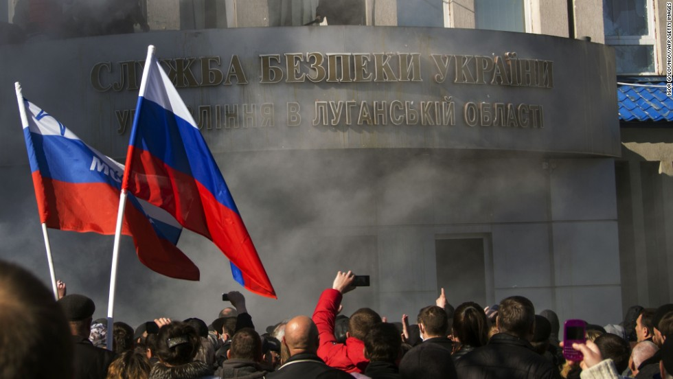 Pro-Russian activists hold a rally in front of a Ukrainian Security Service office in Luhansk on April 6.