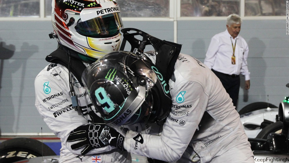The two drivers, who have been friends and rivals since childhood, tussle playfully after Hamilton triumphs for the second race in a row on the 10th anniversary of Formula One arriving in the Middle East.