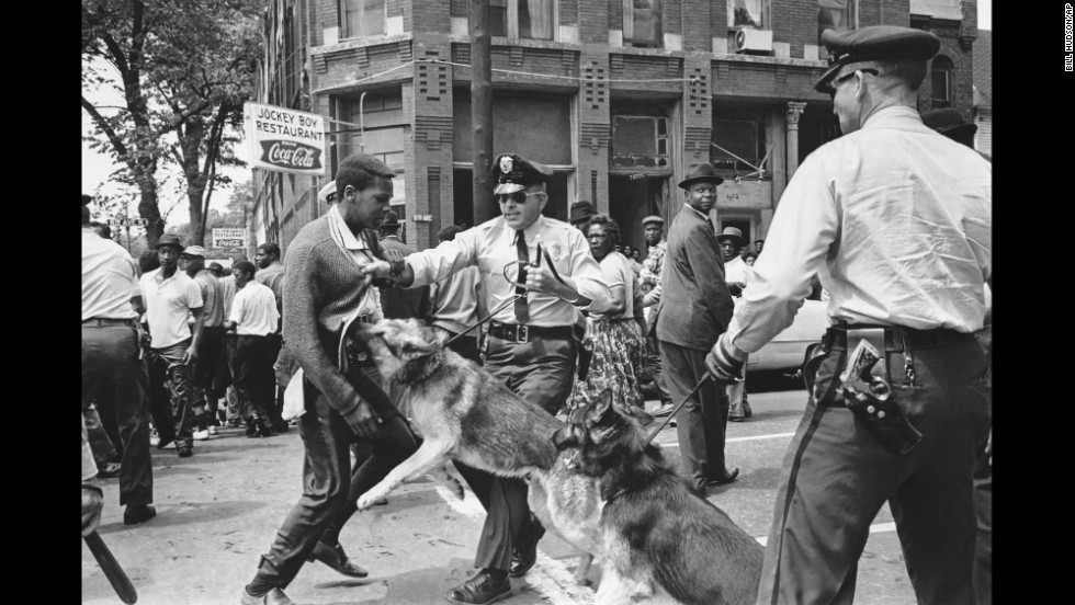 A police dog jumps at a 17-year-old civil rights demonstrator in Birmingham, Alabama, on May 3, 1963. The image appeared on the front page of The New York Times the next day.