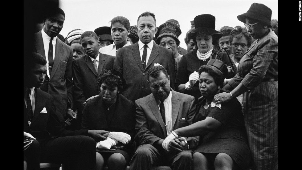 The family of Carol Robertson, a 14-year-old girl killed in the church bombing, attend a graveside service for her in Birmingham on September 17, 1963.