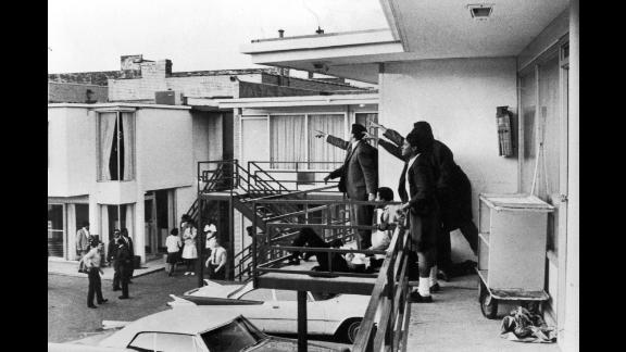 King lies bleeding at the feet of other civil rights leaders after he was shot on the balcony of the Lorraine Motel in Memphis, Tennessee, on April 4, 1968.