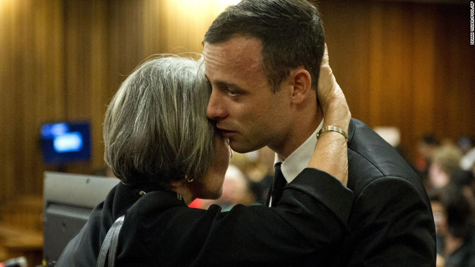 Pistorius is hugged by his aunt Lois Pistorius in court on Monday, April 7.
