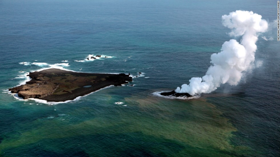 Niijima island spews jets of steam and ash near Nishinoshima island on November 2013. Niijima emerged about 500 meters (550 yards) from the older Nishinoshima.