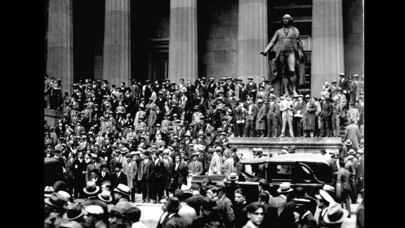 "People gathered across from the New York Stock Exchange on ""Black Thursday,"" October 24, 1929. The stock market crash of 1929, fueled by excessive speculation on Wall Street, set off the Great Depression."