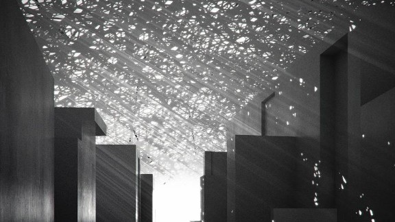 The ceiling of the Louvre Abu Dhabi contains a series of geometric openings so that light can flood into the museum. The pattern is meant to mimic the way light enters a souk.