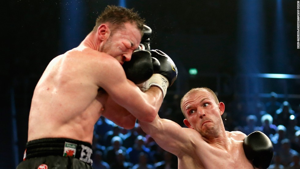Jurgen Brahmer, right, punches Enzo Maccarinelli during their WBA light-heavyweight title fight Saturday, April 5, in Rostock, Germany.
