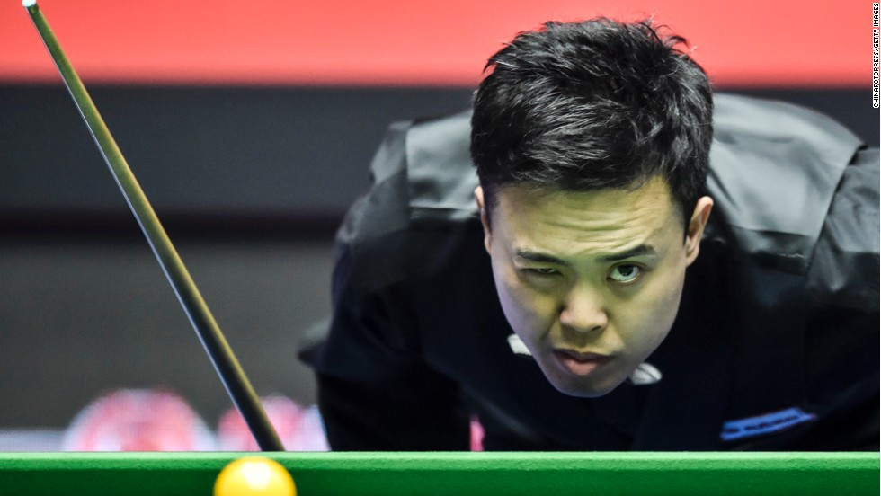 Marco Fu measures a shot during a snooker match at the China Open on Tuesday, April 1, in Beijing.
