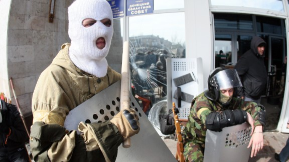Pro-Russian activists guard the main administration building in the eastern Ukrainian city of Donetsk on April 7, 2014, in Donetsk. They proclaimed on April 7 the creation of a sovereign 'people's republic' independent of Kiev's rule.