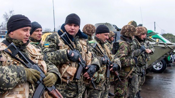 A unit of Ukrainian border guards line up before starting their patrol on the Russian border, in the village of Veseloye, in the Kharkiv region, on April 4, 2014.