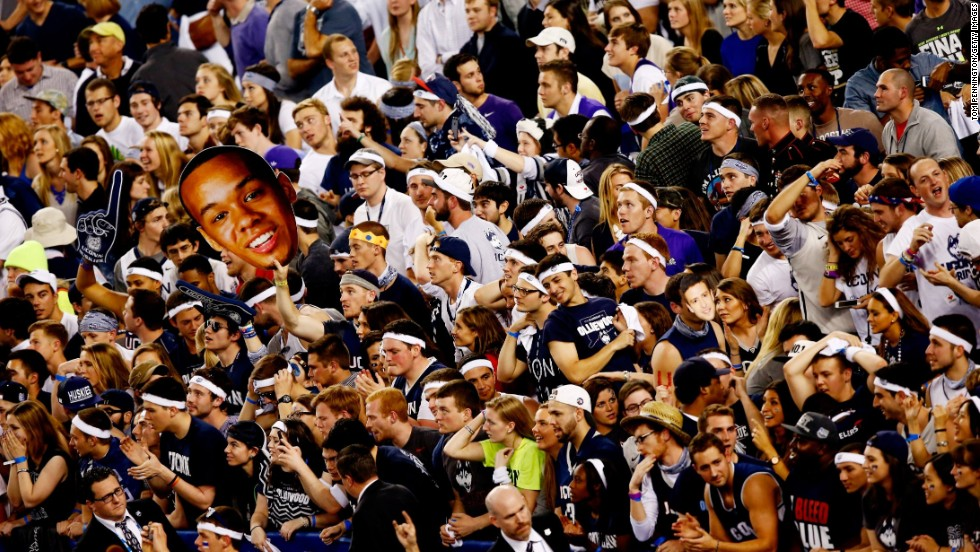 Connecticut fans cheer after the Huskies defeated the Kentucky Wildcats 60-54 in the NCAA Men's Final Four Championship on Monday, April 7, in Arlington, Texas.