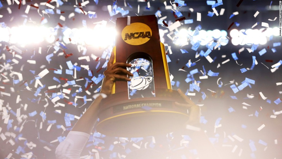 Connecticut celebrates its win with the NCAA championship trophy after defeating the Wildcats.