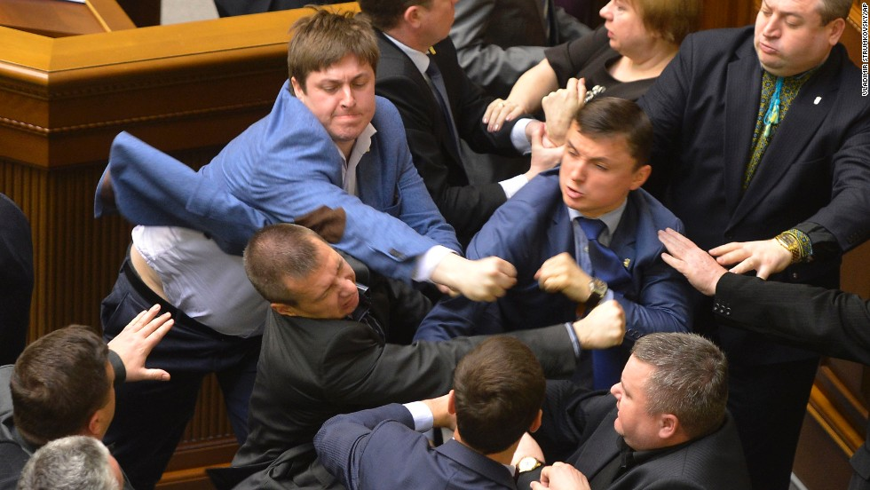 Ukrainian lawmakers from different parties scuffle during a Parliament session in Kiev on Tuesday, April 8.