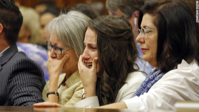Oscar Pistorius' sister Aimee (2nd R), cries as she hears her brother recounts events on the night he killed Reeva Steenkamp.
