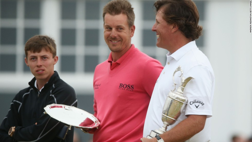 Fitzpatrick won the Silver Medal at the 2013 British Open, as the tournament's leading amateur to complete all 72 holes. He is pictured with runner-up Henrik Stenson (center) and winner Phil Mickelson.