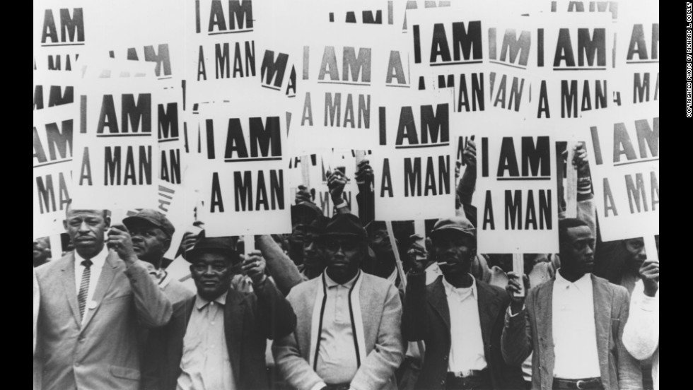"Memphis sanitation workers hold signs with the slogan ""I am a man"" during a strike in 1968. Their campaign against discrimination and poor conditions in the workplace brought King to Memphis."