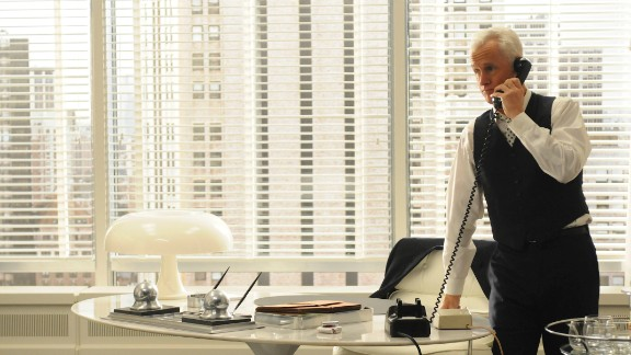 Roger Sterling's three-piece suit in the fourth season represents the division of public and private at the office, Przybyszewski said. Even in 1964, a businessman would keep his jacket on to meet clients and take it off only in the privacy of his office.