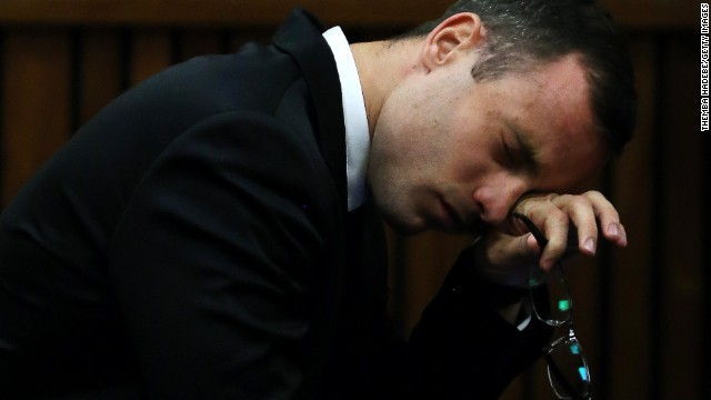 South African Paralympic track star Oscar Pistorius reacts during his trial for the murder of his girlfriend Reeva Steenkamp, at the North Gauteng High Court in Pretoria, on April 7, 2014.