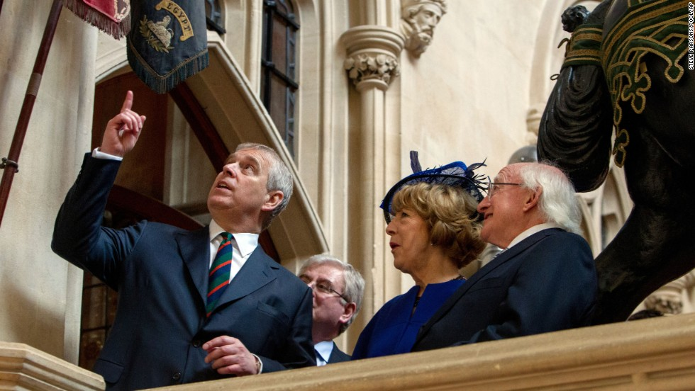 Prince Andrew, Duke of York, shows Higgins and his wife, Sabina, the Colors of the Disbanded Irish Regiments at Windsor Castle on April 9.