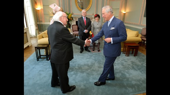 At the start of his visit on April 8, Higgins shakes hands with Britain's Prince Charles at the Irish Embassy in London.
