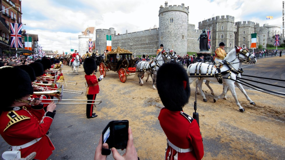 Higgins and Queen Elizabeth travel by state carriage toward Windsor Castle on April 8.