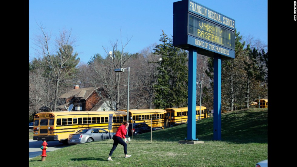 A woman walks onto the campus of the Franklin Regional School District on April 9.