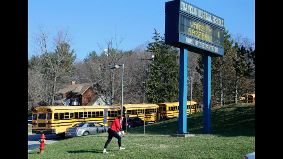 A woman walks onto the campus of the Franklin Regional School District where several people were stabbed at Franklin Regional High School in Murrysville, Pennsylvania, on Wednesday, April 9.