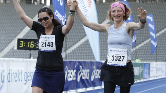 """""""I am still not a strong runner, but I knew I had to finish this race to honor all the people affected by the Boston tragedy,"""" said Ezra Mueller, right, who ran the 25 kilometer """"Big Berlin"""" race in Germany in May with a """"Run for Boston"""" on her back. """"With the support of the other runners loudly cheering me on. I dragged myself across the finish."""""""