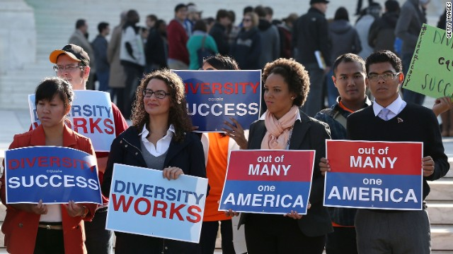 Protesters gather at the U.S. Supreme Court as it hears a case about a university's use of race in its admission policy.
