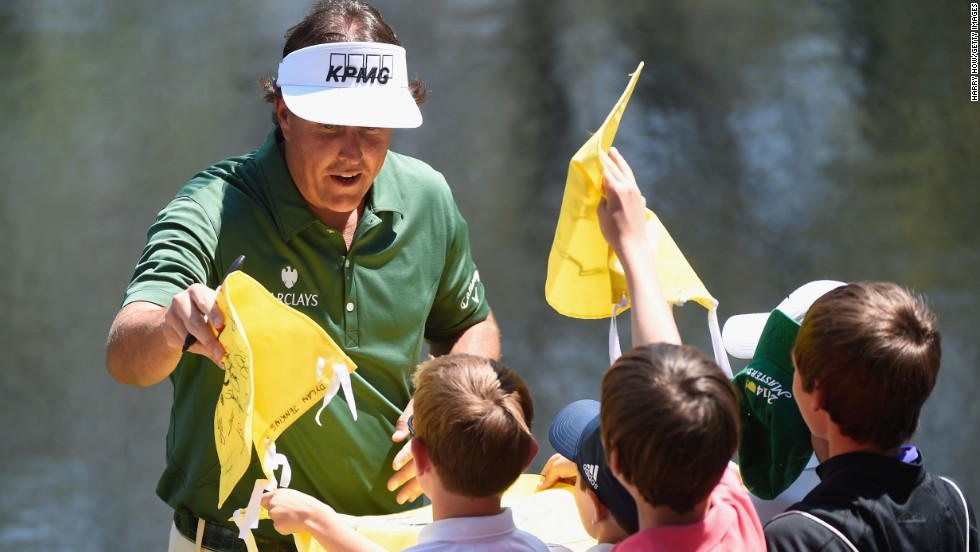 Phil Mickelson, a three-time winner at Augusta, signs autographs ahead of the Par 3 Contest.