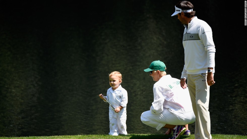 Bubba and Angie Watson wait with their son Caleb on the ninth green. Watson won the Augusta Masters in 2012.