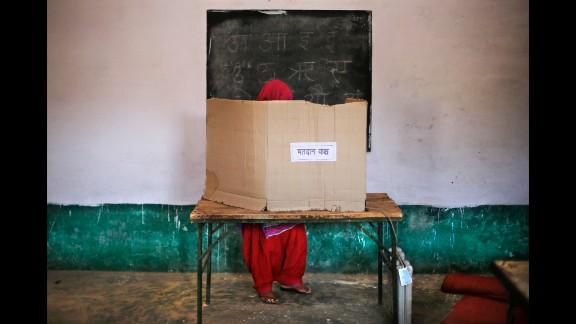 A woman casts her vote in Muzaffarnagar, India, on April 10.