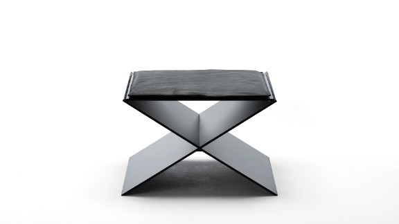 This Living Divani minimalist stool, by Spanish designer David Lopez Quincoces, combines two aluminum plates which create an X-shaped seat. Its clean, geometric lines are softened by a slim, elegant cushion.