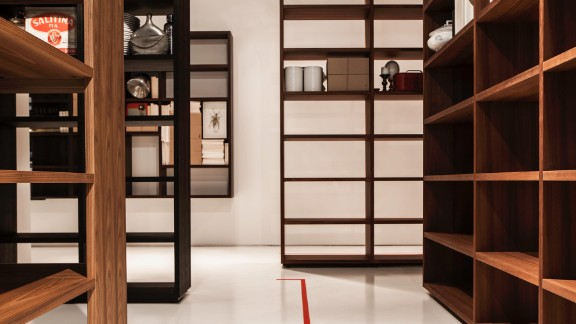"Italian house Porro presented ""Woodenland"", a labyrinthine bookcase installation by designer Piero Lissoni."