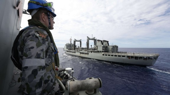 This handout photo taken on April 7, 2014 and released on April 9, 2014 by Australian Defence shows Maritime Warfare Officer, Sub Lieutenant Ryan Penrose watching HMAS Success as HMAS Perth approaches for a replenishment at sea while searching for missing Malaysia Airlines flight MH370 in the southern Indian Ocean. Two fresh signals have been picked up Australian ship Ocean Shield in the search for missing Malaysian flight MH370, raising hopes that wreckage will be found within days even as black box batteries start to expire.