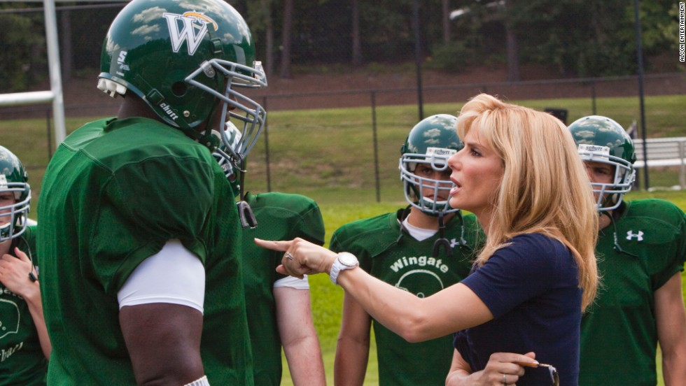 """The Blind Side"" (2009): Quinton Aaron, playing Michael Oher, is ""coached"" by Oscar winner Sandra Bullock."