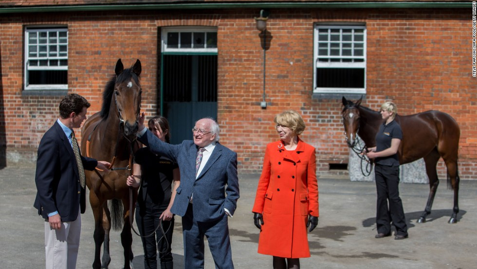 Higgins and his wife, Sabina, meet the Queen's race horses Micras and Enliven in Newbury, England, on April 10.