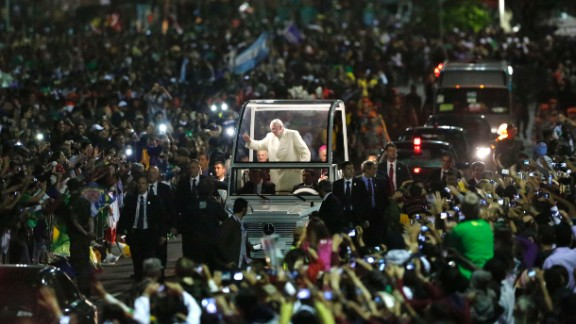 Crowds swarm the Pope as he makes his way through World Youth Day in Rio de Janeiro in July 2013. According to the Vatican, 1 million people turned out to see the Pope.