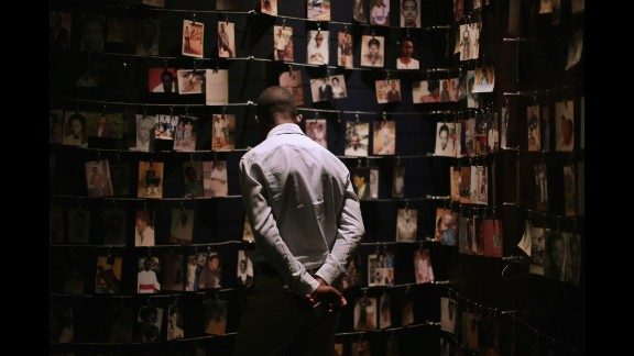 Family photos of victims of the 1994 Rwanda genocide hang inside the Kigali Genocide Memorial Centre in the country
