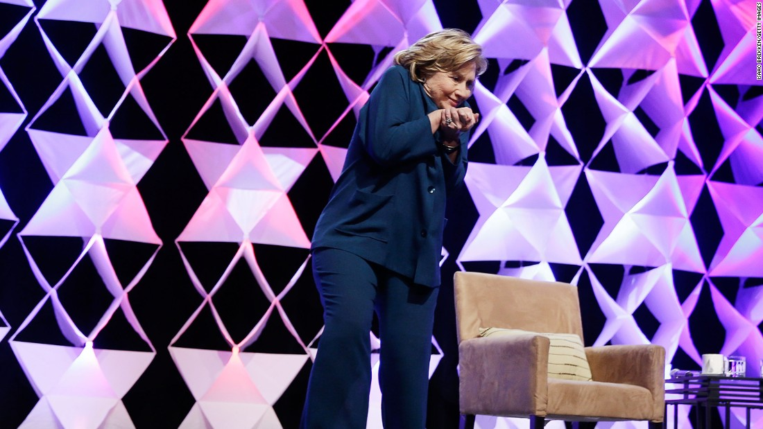 Hillary Clinton ducks after a woman threw a shoe at her while she was delivering remarks in Las Vegas on April 10, 2014.