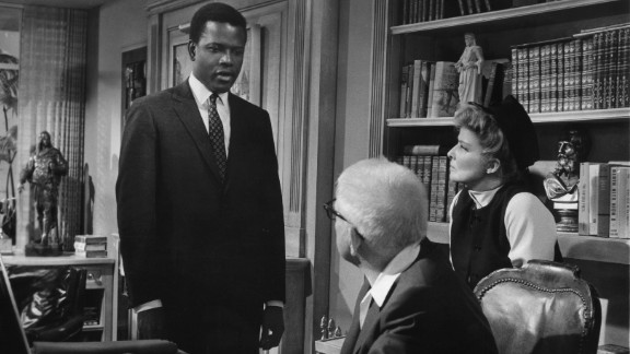 "Poitier plays an idealistic -- and idealized -- doctor in 1967's ""Guess Who's Coming to Dinner."" His character is planning to marry the daughter of upstanding San Franciscans played by Spencer Tracy and Katharine Hepburn -- if they approve of the union. The film was another huge hit."