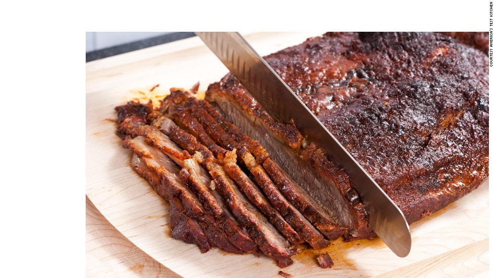 SLICE AND ENJOY: Slice the brisket across the grain and serve it with the sauce.<br />WHY? The brisket is a hardworking muscle with a heavy grain. Slicing across the grain ensures that it's tender.