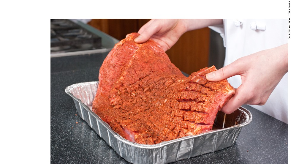 SET IN PAN: Blot the brisket dry and place it in a disposable pan.<br />WHY? A dry brisket forms a better crust. The pan keeps the brisket from burning while letting it develop char and absorb smoke. And it catches the juices for the sauce.<br />