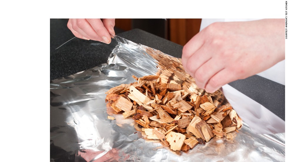 MAKE FOIL PACKET: Briefly soak the wood chips (hickory is traditional) in water, drain and wrap in foil. Cut vent holes.<br />WHY? For subtle smokiness. The wrapped chips won't burn too fast, while the vents let the smoke escape gradually and flavor the brisket.<br />