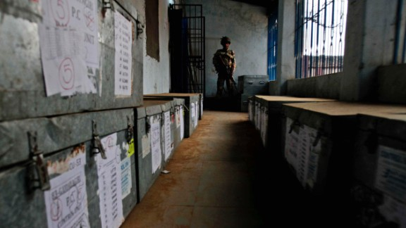 A paramilitary soldier stands guard inside a room containing ballot boxes on April 10.