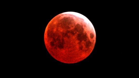 A blood moon is seen over Gaza City in March 2007.