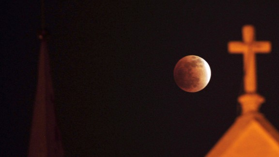 A total lunar eclipse is seen in Karachi, Pakistan, on December 10, 2011.