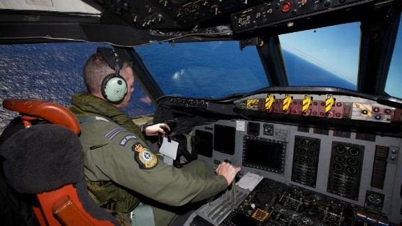 Captain Flt. Lt. Tim McAlevey of the Royal New Zealand Air Force flies a P-3 Orion in search for the missing Malaysia Airlines Flight 370 over the Indian Ocean, Friday, April 11, 2014. Authorities are confident that signals detected deep in the Indian Ocean are from the missing Malaysian jet's black boxes, Australian Prime Minister Tony Abbott said Friday, raising hopes they are close to solving one of aviation's most perplexing mysteries. Abbott told reporters in Shanghai that crews hunting for Flight 370 have zeroed in on a more targeted area in their search for the source of the sounds, first heard on Saturday. (AP Photo/Richard Wainwright, Pool)