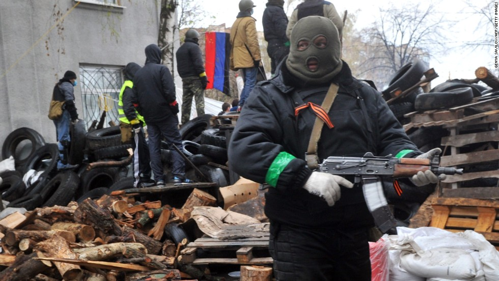 Pro-Russian protesters guard a barricade in Slovyansk on April 13 outside a regional police building seized by armed separatists the day before.