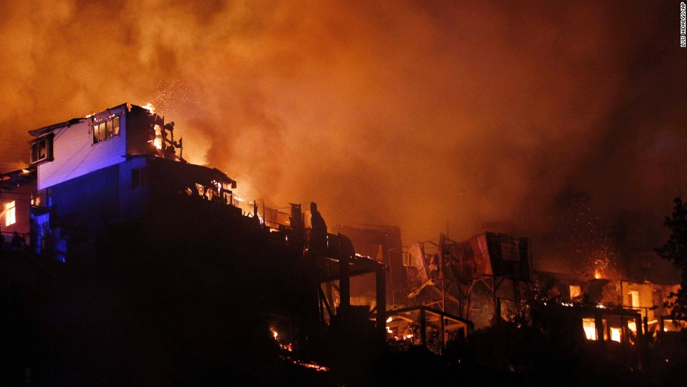 The out-of-control wildfire destroys homes in Valparaiso on April 13.